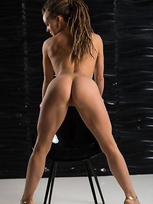 Tova confidently showcases her firm, athletic body with wide open, flexible poses.